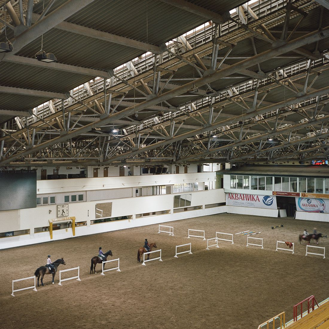 View of the indoor arena at Bitza Equestrian Complex. The complex completed in 1980 remains Europe's largest equestrian complex. The complex hosted all equestrian venues during the olympics and currently continues to be used for equestrian sports.