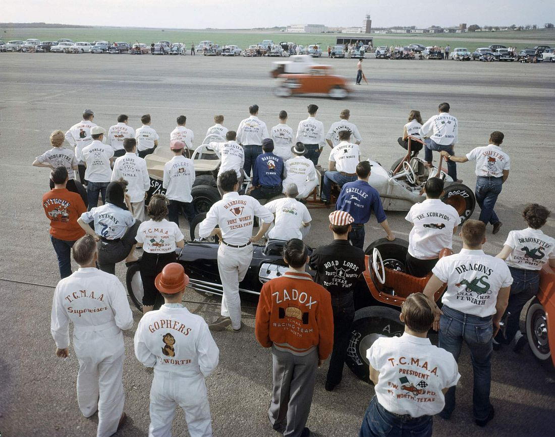 Subject: crowd of dragsters watching drag racing at Eagle Mt. Fort Worth, Texas 1957 Photographer- A.Y. Owen Time Inc NOT OWNED merlin- 1202948