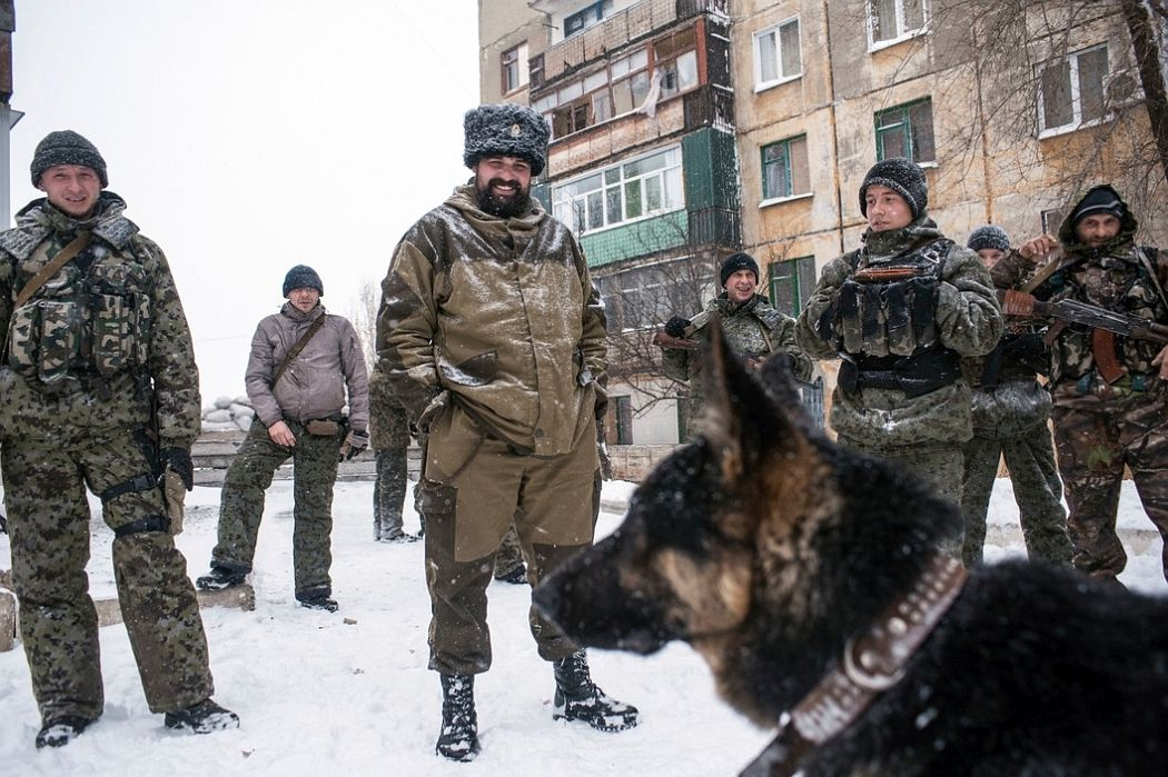 UKRAINE. Shahanov, East Ukraine. November 30, 2014. Cossack separatists at the front line with German shepherd patrol dog.