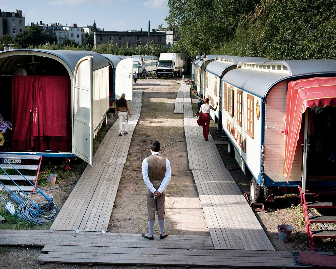 A row of caravans with artists.