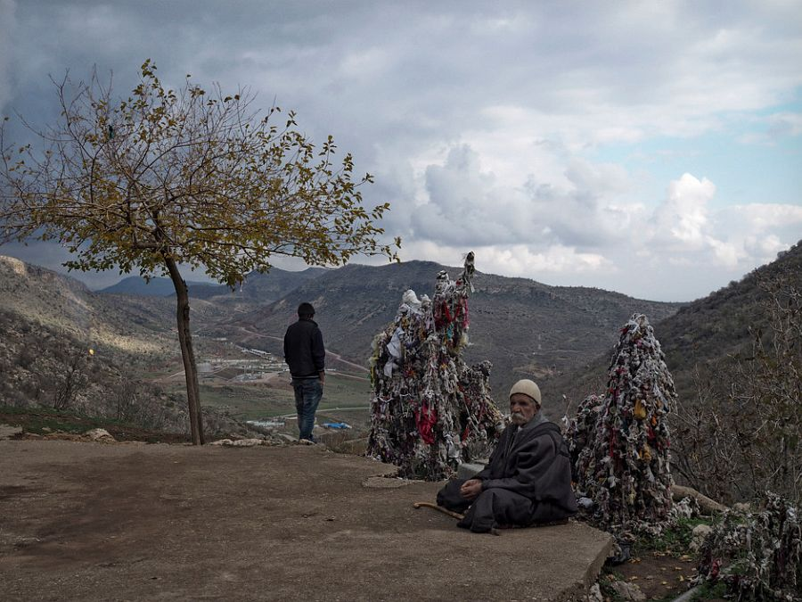 IRAQ. Kurdistan. November 28, 2014. Yazidi men displaced from Sinjar by the advance of the Islamic State, living in the mountain village of Lalesh, in Iraq's Nineveh Province. Lalesh is the site of the sacred tomb of Sheikh Adi in Musafir, the main figure in the Yazidi faith.