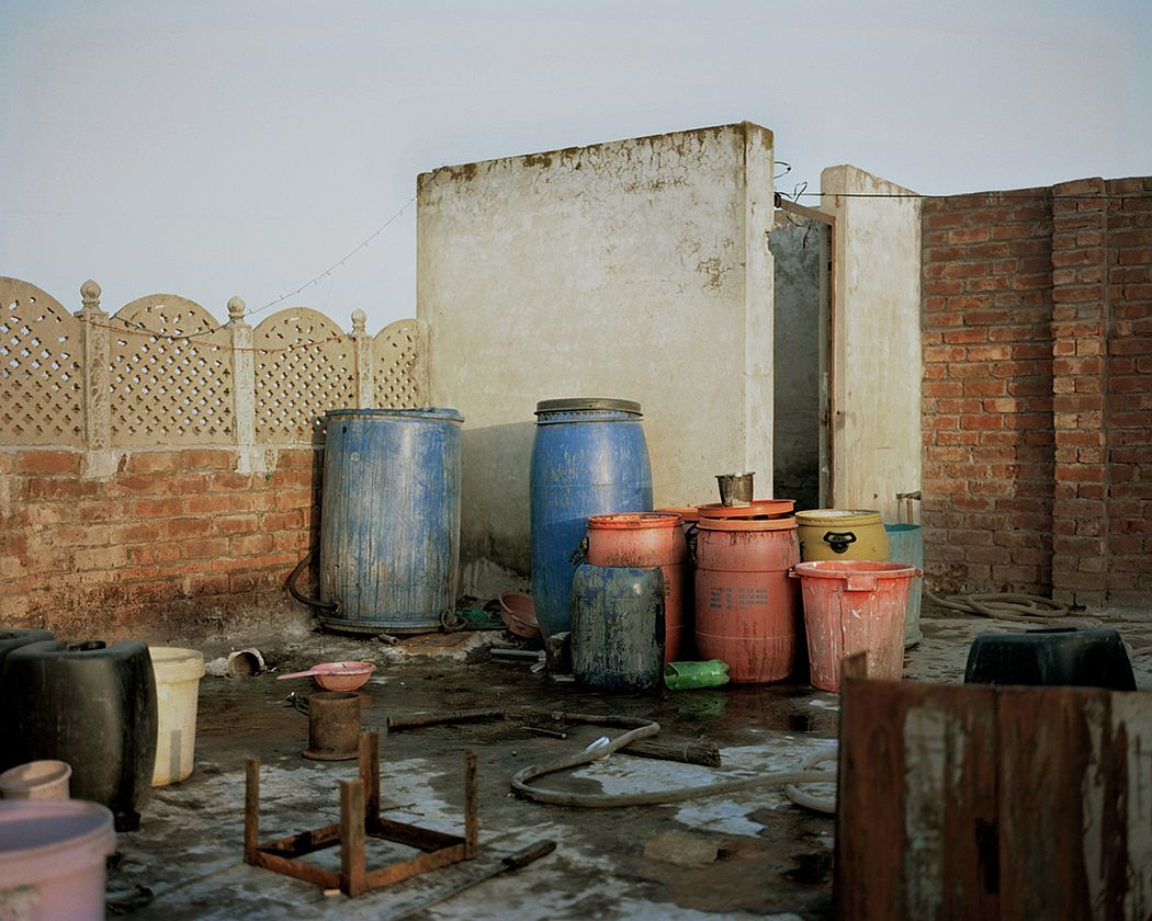 Walton Road, Lahore, Pakistan. On the roof of a building, bins full of chemicals that will be used for the extraction of precious metals from electronic waste.