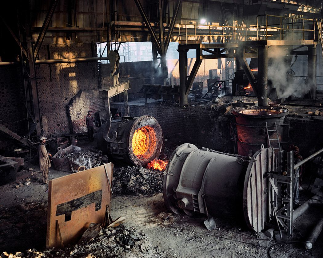Wagha Town, Lahore, Pakistan. Trucks full of metallic materials coming from the disposal of electric and electronic waste arrive to this foundry daily. Here the metal, along with some other metal scrap of different provenience, is melted at a temperature of 1800 degrees Celsius. In this way, they create new metallic materials and use it in the construction field.