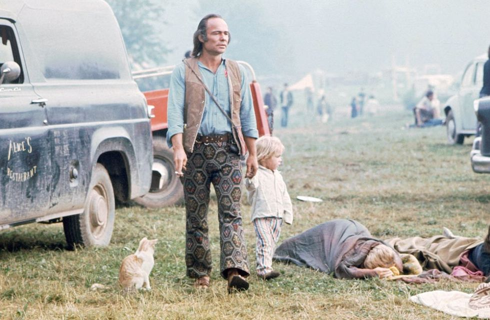 Image: Ralph Ackerman / Time Life Pictures / Getty Images - Walking Through Woodstock, sleeping sleeping bags on the ground, Alice's Restaurant vintage delivery van