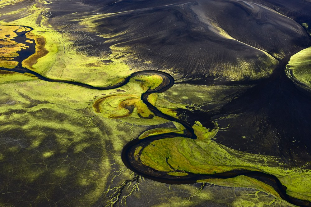 River valley in Fjallabak covered with fluorescent moss, Iceland