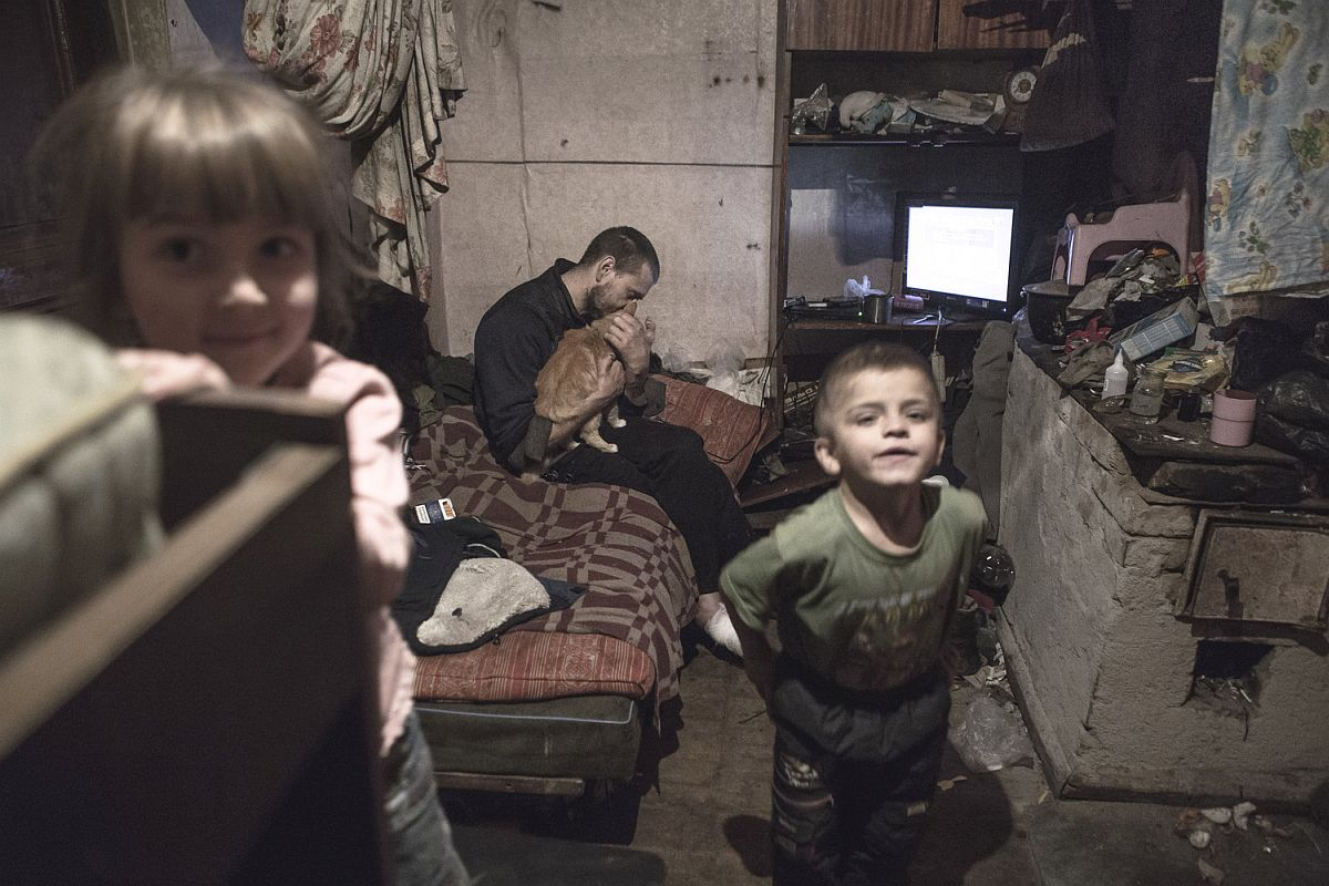 Ruslan's house burned down a few years ago; today, he is living in a shabby hut in the outskirts of town. There is no water supply, sewers, or central heating.