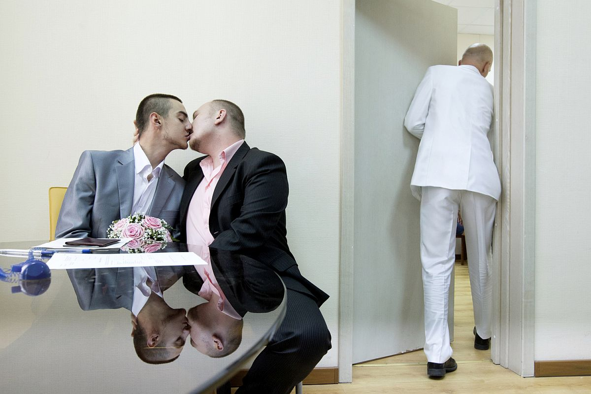 Yaroslav Yevtushenko (left) embraces his boyfriend Dmitry Chunosov at St. Petersburg's registry office where the couple attempts to officially register their marriage as an act of protest. Since same sex marriages are not recognised in Russia their submission was promptly rejected by the authorities.