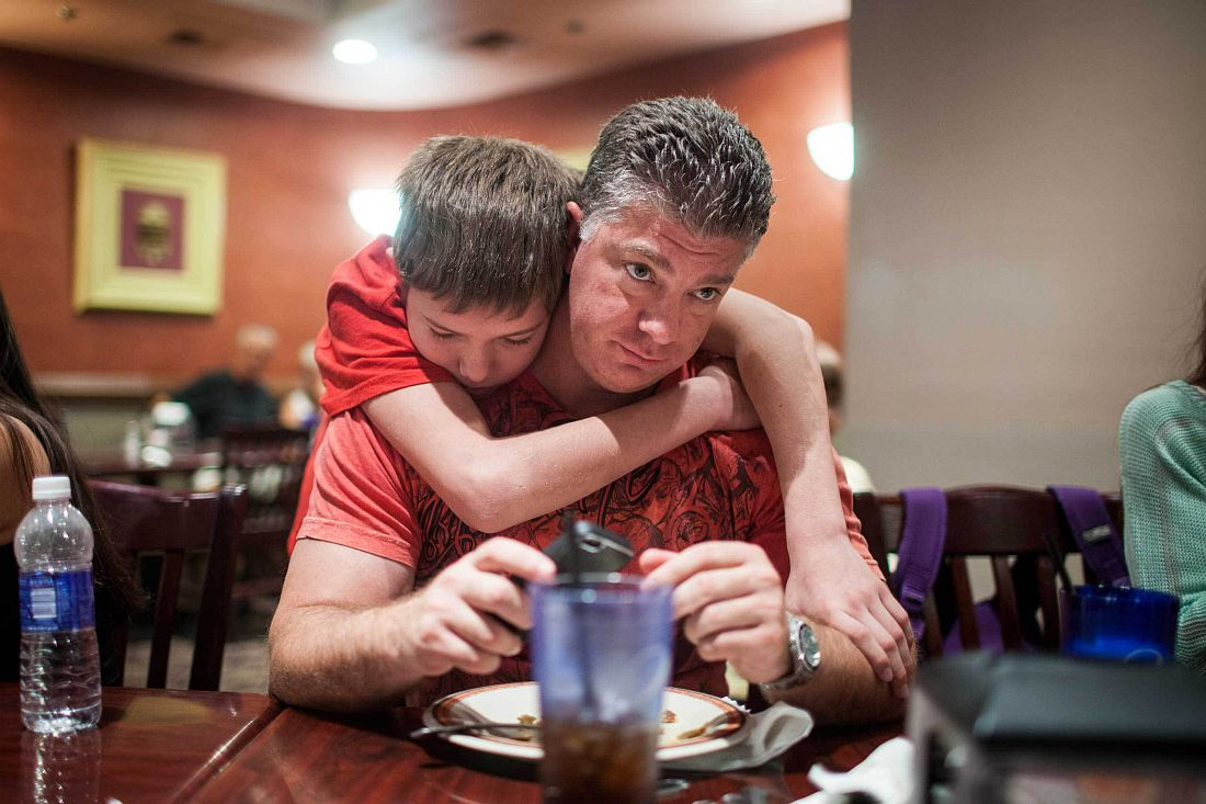 Mixed Martial Arts fighter Cade Rogue, 9, hugs his dad Jason, before fighting in the octagon in a United States Fight League(USFL) All-star Pankration show at Blue Water Casino in Parker, Arizona on 25th of October 2013. Photo: Miikka Pirinen