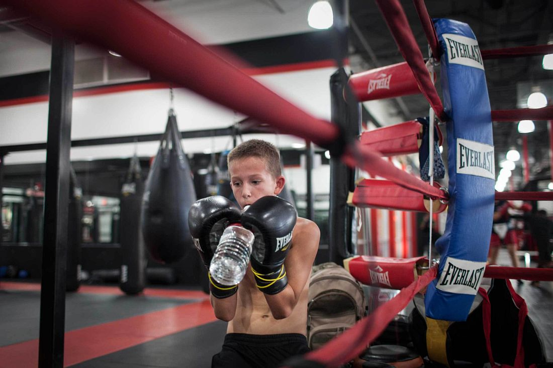 William Reid, 10, at a private boxing class in Power MMA gym, Mesa, Arizona, November 19th 2013. Photo: Miikka Pirinen
