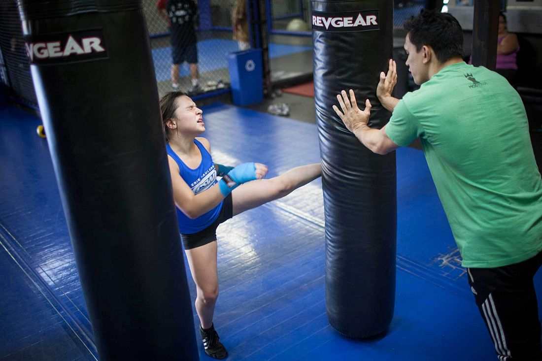 Cheyenne Bowman, 11, at personal MMA practice with coach Craig Wilkerson, a professional MMA fighter. La Habra, CA. November 11th 2013. Photo: Miikka Pirinen