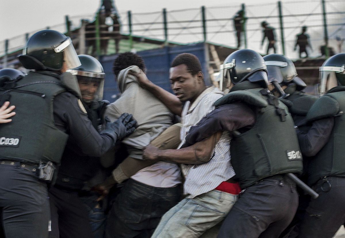 Once they have jumped the fence, immigrants to Spain struggle with police to avoid being deported to Morocco.