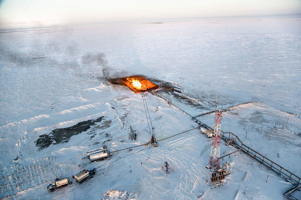 The flaring of gas is seen overhead at a drilling well in Novy Urengoi, Arctic Siberia, Russia, December 2014.