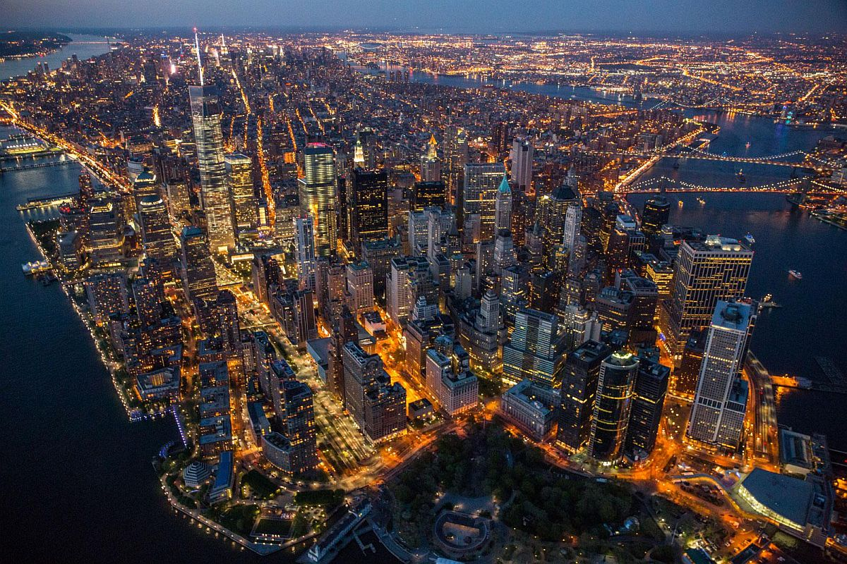 At twilight, Manhattan resembles a vast living organism with ribbons of energy pulsing through its streets and up into its hundred thousand buildings.