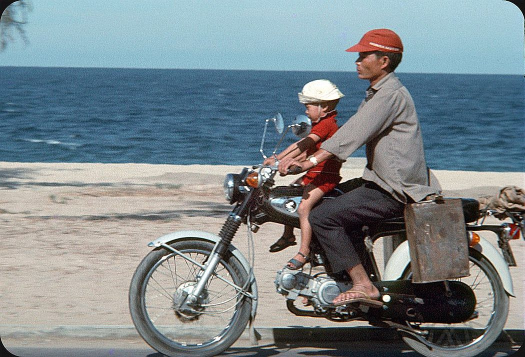 people-riding-motorcycles-on-the-streets-in-vietnam-in-1969-07